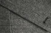 Lapel and pocket of a classic gray tweed coat — Stock Photo