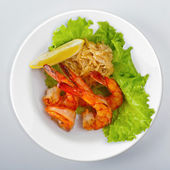 Fresh grilled shrimps on white plate — Stock Photo