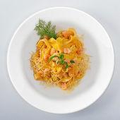 Pasta On white round dish — Stock Photo