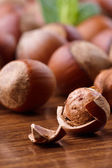 Hazelnuts on wooden table — Stock Photo