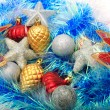 Christmas ornaments, stars, cones, balls, tinsel. — Foto de Stock   #66232775