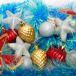 Christmas ornaments, stars, cones, balls, tinsel. — Foto de Stock   #66232979
