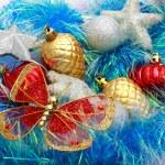 Christmas ornaments, stars, cones, balls, tinsel. — Stock Photo #66232985