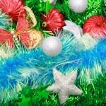 Christmas ornaments, stars, cones, balls, tinsel. — Stock Photo #66233013