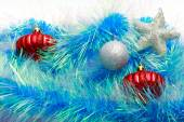 Christmas ornaments, stars, cones, balls, tinsel. — Stock Photo