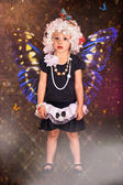 Surprised girl-butterfly — Stock Photo