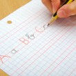 Closeup on the hands of a child doing writing activity as part of homework. School concept. — Stock Photo #63849581