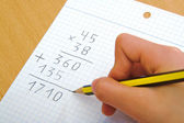 Child doing a math multiplication at school. — Stock Photo