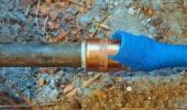 Cold water pipe on broken floor — Stock Photo