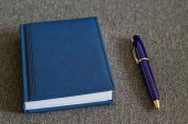 Note Pad and  Blue Pen. — Stock Photo