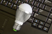 Close up Led Bulb at the keyboard background. — Stock Photo