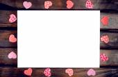 Red hearts around the white sheet — Stock Photo