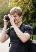 Portrait of a squinting photographer — Stock Photo