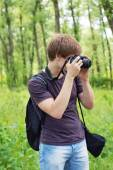 Portrait of a photographer in park — Stock Photo