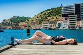 Girl lies on the dock — Stock Photo