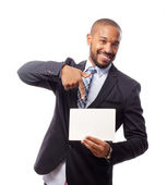 Young cool black man with a palcard — Stock Photo