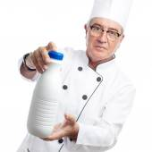 Senior cool man with a milk bottle — Stock Photo