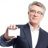 Senior cool man with a name card — Stock Photo
