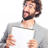 Young crazy man with a notebook — Stock Photo