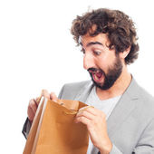 Young crazy man with a bag — Stock Photo