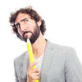 Young crazy man with pencil — Stock Photo