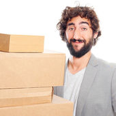 Young crazy man with boxes — Stock Photo