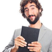 Young crazy man with a book — Stock Photo