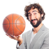 Young crazy man with a basket ball — Stock Photo