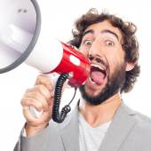 Young crazy man with a megaphone — Stock Photo