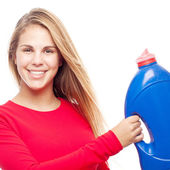 Young cool woman with detergent — Stock Photo