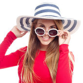 Young cool woman with sunglasses and hut — Stock Photo