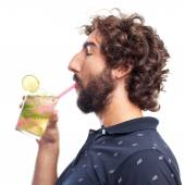 Young crazy man drinking — Stock Photo
