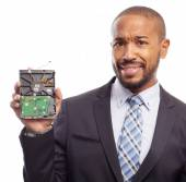 Young cool black man with a hard disk — Stock Photo