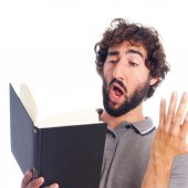 Young crazy man interpreting with a book — Stock Photo