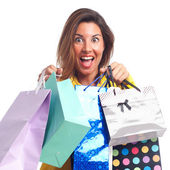 Young cool woman with shopping bags — Stockfoto