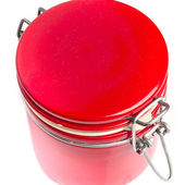Red jar un an striped background — Stock Photo