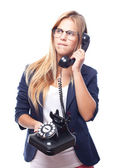 Young cool woman doubting at phone — Stock Photo
