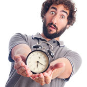 Young bearded man with a clock — Foto Stock
