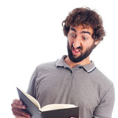 Young crazy man stranged with a book — Foto Stock