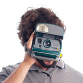 Young crazy man with a photo camera instant — Foto Stock