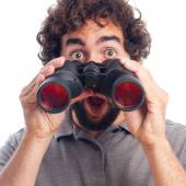 Young bearded man with binoculars — Stock Photo