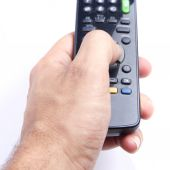 Man hand holding a tv remote — Stock Photo