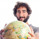 Young bearded man with world globe — Стоковое фото