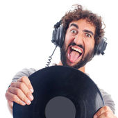 Young bearded man with headphones and disk — Foto Stock