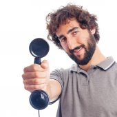 Young crazy man with a telephone — Stock Photo