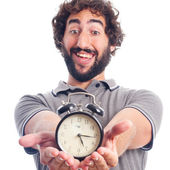 Young crazy man with a clock — Stock Photo