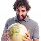 Young bearded man with world globe — Stockfoto