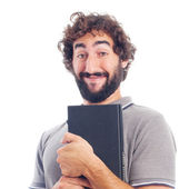 Young crazy man happy with a book — Stock Photo