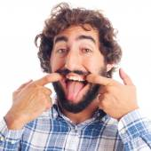 Young man mocking grin — Stock Photo