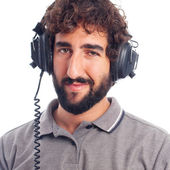 Young bearded man with headphones — Stockfoto